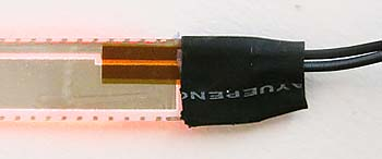 back of the el tape with wires attached