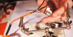 warm the heatshrink to finish the el wire repair