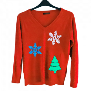 el panels in the shape fo snow flakes and christmas trees on a red jumper with flashing option